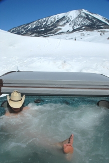 hot tub in winter at the gunnison vacation cabin in colorado